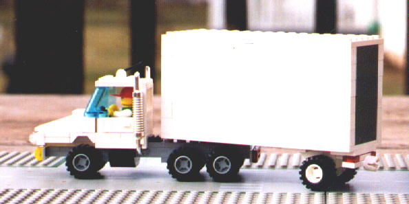 A Conventional Slope Nose Tractor With Short Trailer Picture On The Right Shows Dolly For Use When Pulling Multiple Trailers